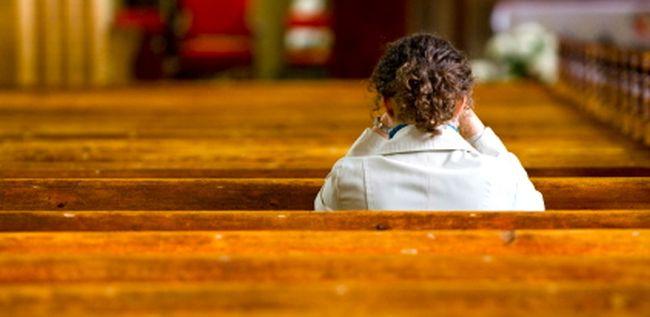 young-woman-praying-in-church