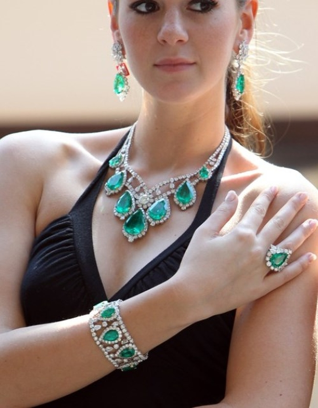 A model presents a Jahan diamond and emerald jewellery set at Christie's auction house in Dubai on October 24, 2010, prior to a jewels and watches auction in the Gulf emirate on October 27. AFP PHOTO/KARIM SAHIB (Photo credit should read KARIM SAHIB/AFP/Getty Images)